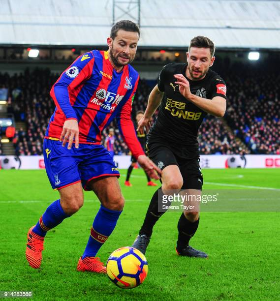 Paul Dummett of Newcastle United challenges Yohan Cabaye of Crystal Palace during the Premier League match between Crystal Palace and Newcastle...