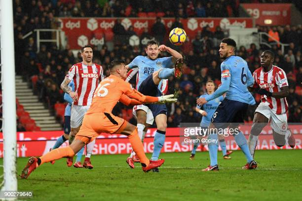 Paul Dummett of Newcastle United clears the ball during the Premier League match between Stoke City and Newcastle United at Bet365 Stadium on January...