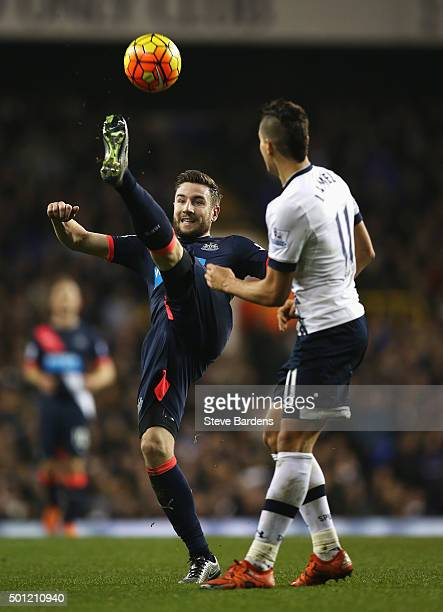Paul Dummett of Newcastle United clears the ball from Erik Lamela of Tottenham Hotspur during the Barclays Premier League match between Tottenham...
