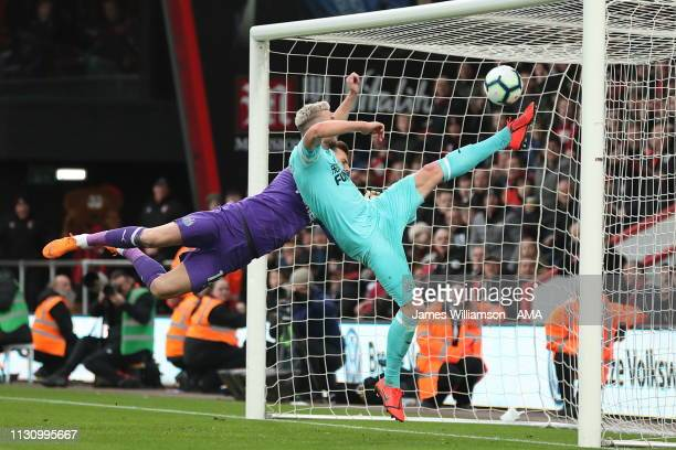 Paul Dummett of Newcastle United clears the header of Nathaniel Clyne of Bournemouth off the line during the Premier League match between AFC...