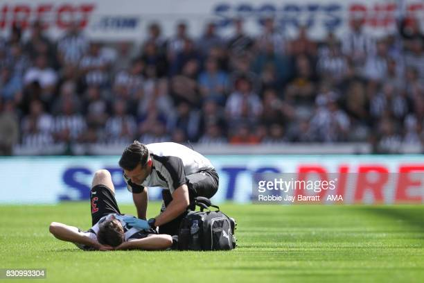Paul Dummett of Newcastle United down injured during the Premier League match between Newcastle United and Tottenham Hotspur at St James Park on...