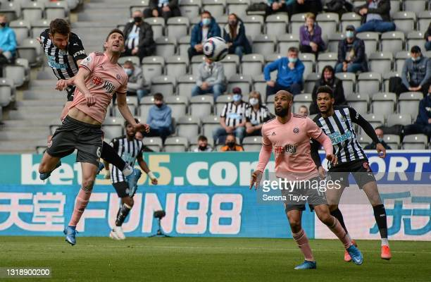 Paul Dummett of Newcastle United FC heads the ball during the Premier League match between Newcastle United and Sheffield United at St. James Park on...