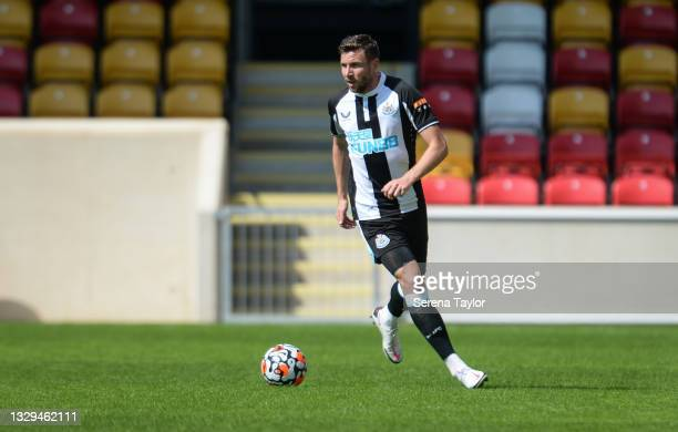 Paul Dummett of Newcastle United FC looks to pass the ball during the Pre Season Friendly between York City and Newcastle United at the LNER...