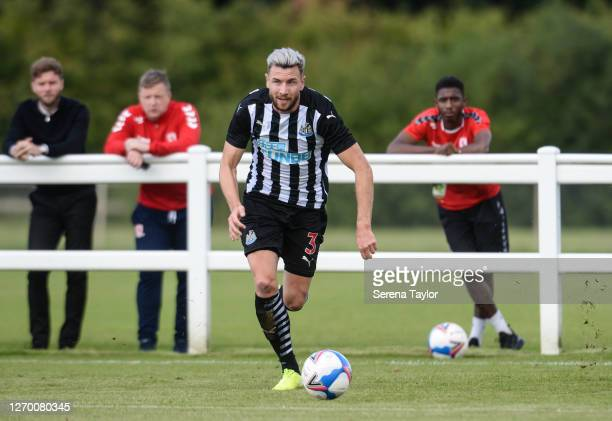Paul Dummett of Newcastle United FC runs with the ball during the Pre Season Friendly between Newcastle United and Middlesbrough FC at the Rockliffe...