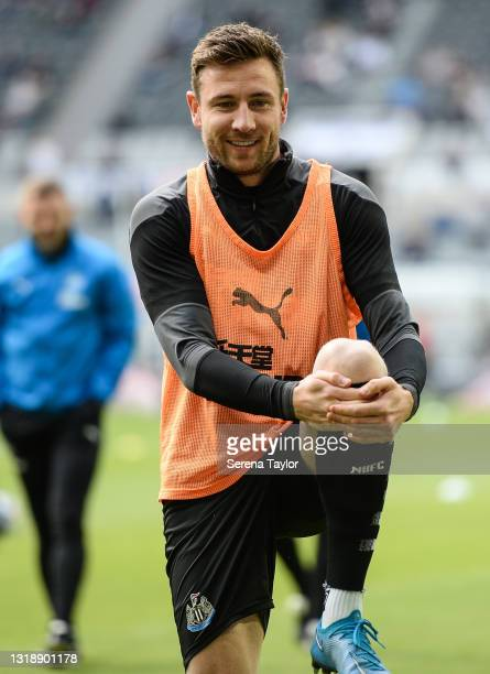 Paul Dummett of Newcastle United FC warms up for his 200th game ahead of the Premier League match between Newcastle United and Sheffield United at...