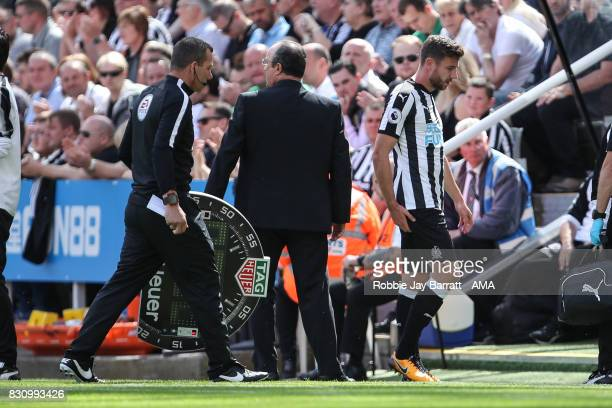 Paul Dummett of Newcastle United goes off injured during the Premier League match between Newcastle United and Tottenham Hotspur at St James Park on...