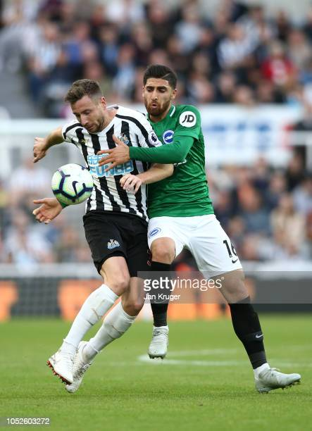 Paul Dummett of Newcastle United is challenged byAlireza Jahanbakhsh of Brighton and Hove Albion during the Premier League match between Newcastle...