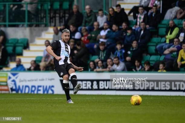 Paul Dummett of Newcastle United passes the ball during the PreSeason Friendly match between Hibernian FC and Newcastle United at Easter Road on July...