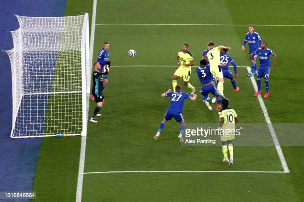 Paul Dummett of Newcastle United scores his team's second goal past Kasper Schmeichel of Leicester City during the Premier League match between...