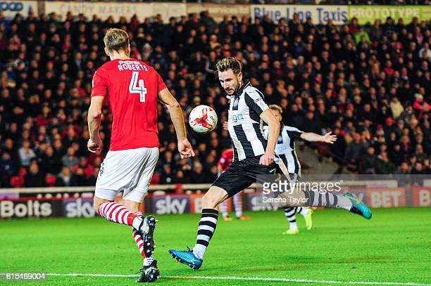 Paul Dummett of Newcastle United strikes the ball during the Sky Bet Championship Match between Barnsley and Newcastle United at Oakwell Stadium on...