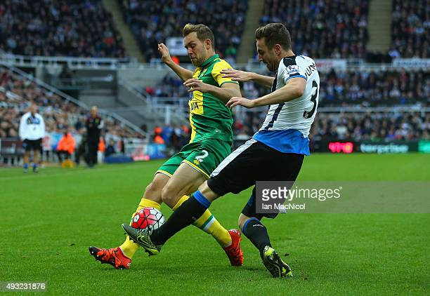 Paul Dummett of Newcastle United tackles Steven Whittaker of Norwich City during the Barclays Premier League match between Newcastle United and...