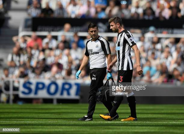 Paul Dummett of Newcastle United walks off injured during the Premier League match between Newcastle United and Tottenham Hotspur at St James Park on...