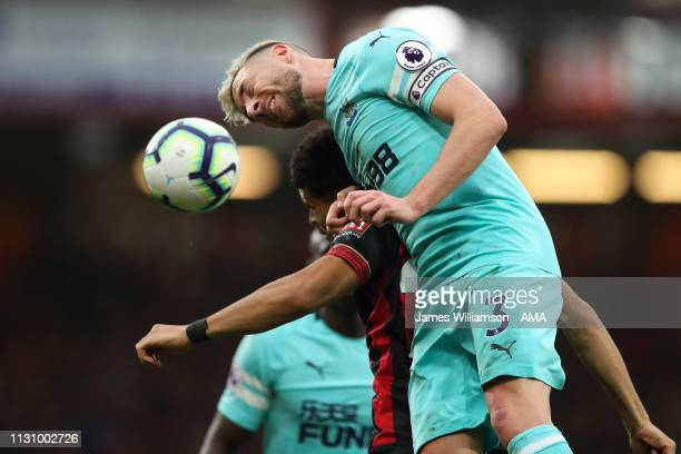 Paul Dummett of Newcastle United wins a header against Dominic Solanke of Bournemouth during the Premier League match between AFC Bournemouth and...