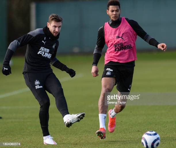 Paul Dummett passes the ball as Joelinton applies pressure during the Newcastle United Training session at the Newcastle United Training Centre on...