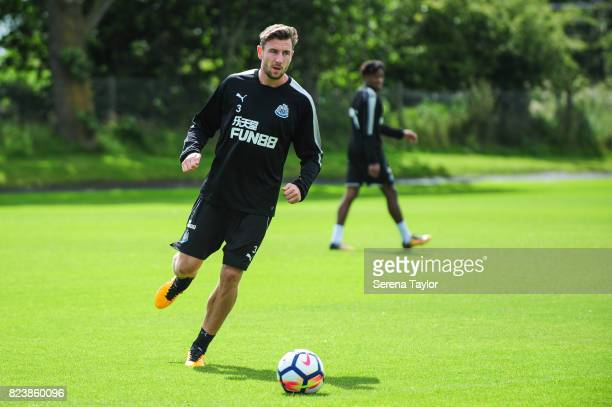 Paul Dummett passes the ball during the Newcastle United Training session at the Newcastle United Training ground on July 28 in Newcastle upon Tyne...