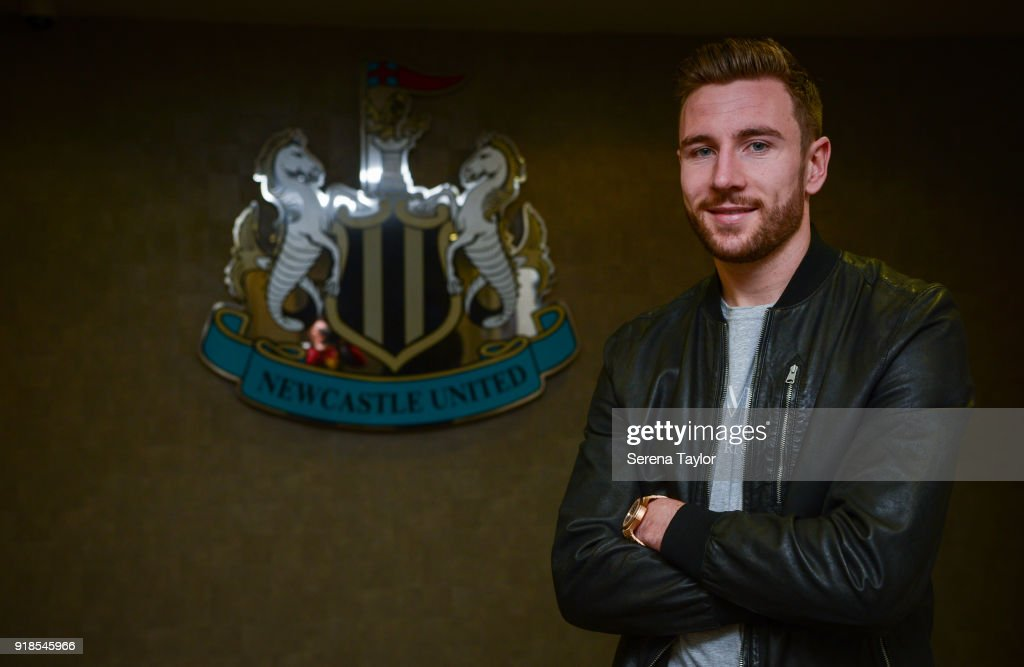 Paul Dummett poses for photos with the clubs crest at St.James' Park after signing a Contract Extension in Newcastle upon Tyne on February 15, 2018, in Newcastle upon Tyne, England.