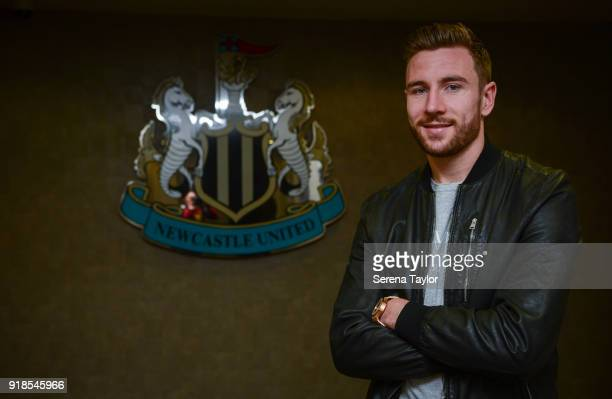 Paul Dummett poses for photos with the clubs crest at StJames' Park after signing a Contract Extension in Newcastle upon Tyne on February 15 in...