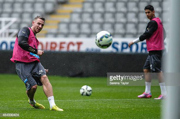 Paul Dummett strikes the ball during a Newcastle United Training Session at StJames Park on August 29 in Newcastle upon Tyne England