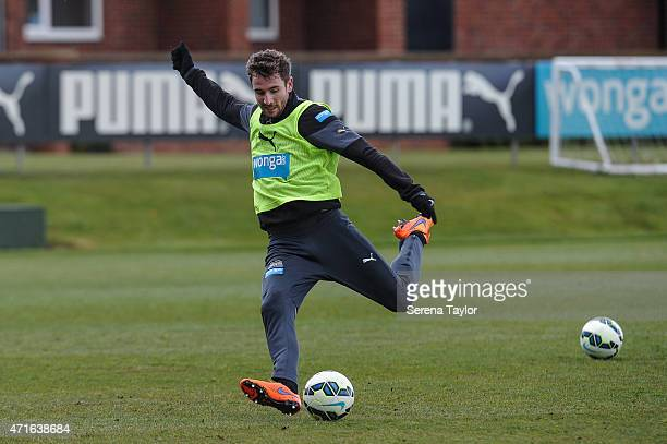 Paul Dummett strikes the ball during a Newcastle United Training session at The Newcastle United Training Centre on April 30 in Newcastle upon Tyne...