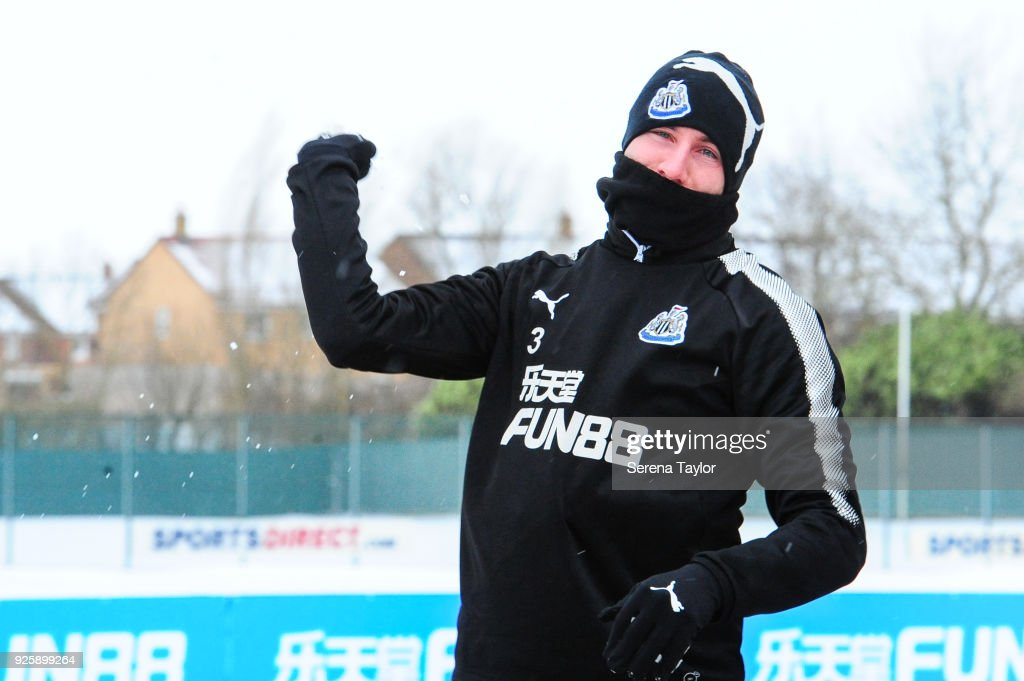 Paul Dummett throws a snowball as he walks outside during the Newcastle United Training Session at the Newcastle United Training Centre on March 1, 2018, in Newcastle upon Tyne, England.