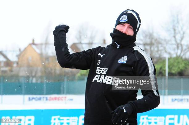 Paul Dummett throws a snowball as he walks outside during the Newcastle United Training Session at the Newcastle United Training Centre on March 1 in...
