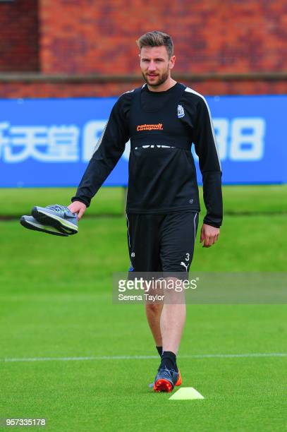 Paul Dummett walks out carrying trainers during the Newcastle United Training Session at the Newcastle United Training Centre on May 11 in Newcastle...