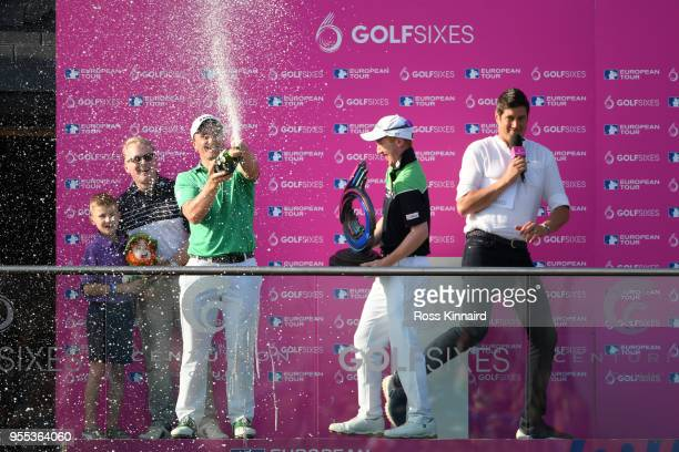 Paul Dunne and Gavin Moynihan of Ireland celebrate victory with champagne during day two of the GolfSixes at The Centurion Club on May 6 2018 in St...