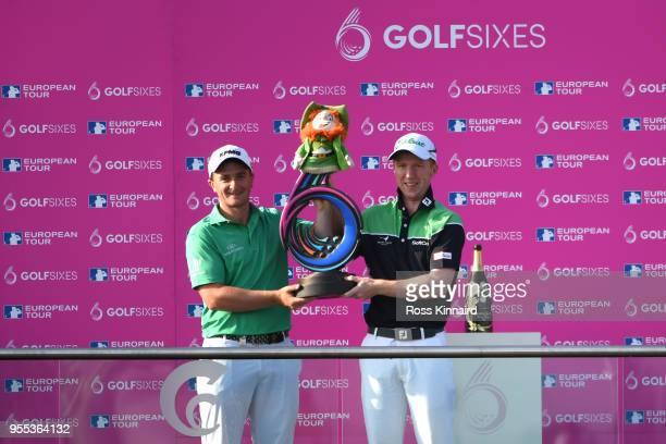 Paul Dunne and Gavin Moynihan of Ireland celebrate victory with the trophy during day two of the GolfSixes at The Centurion Club on May 6 2018 in St...