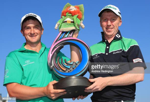 Paul Dunne and Gavin Moynihan of Ireland pose with the trophy following their victory during day two of the GolfSixes at The Centurion Club on May 6...