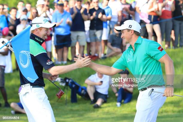 Paul Dunne of Ireland and Gavin Moynihan of Ireland celebrate winning the final match during day two of the GolfSixes at The Centurion Club on May 6...