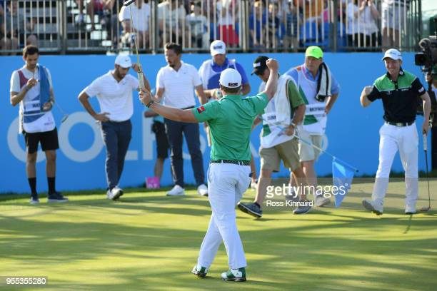 Paul Dunne of Ireland celebrates holing the winning putt to win the final match during day two of the GolfSixes at The Centurion Club on May 6 2018...