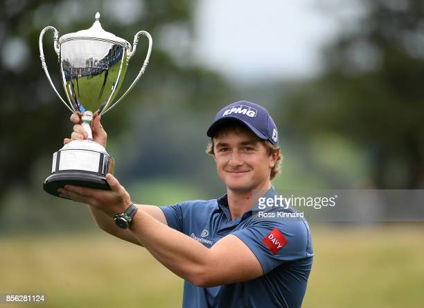Paul Dunne of Ireland celebrates with the trophy during day four of the British Masters at Close House Golf Club on October 1 2017 in Newcastle upon...
