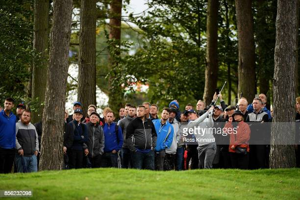 Paul Dunne of Ireland hits his second shot on the 12th hole during day four of the British Masters at Close House Golf Club on October 1 2017 in...