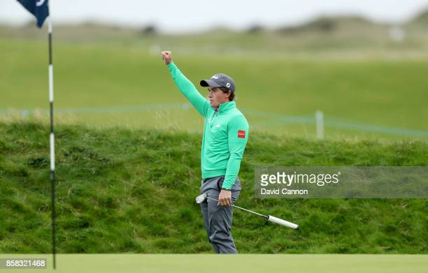 Paul Dunne of Ireland holes his second shot on the 16th hole for a birdie during the second round of the 2017 Alfred Dunhill Links Championship on...