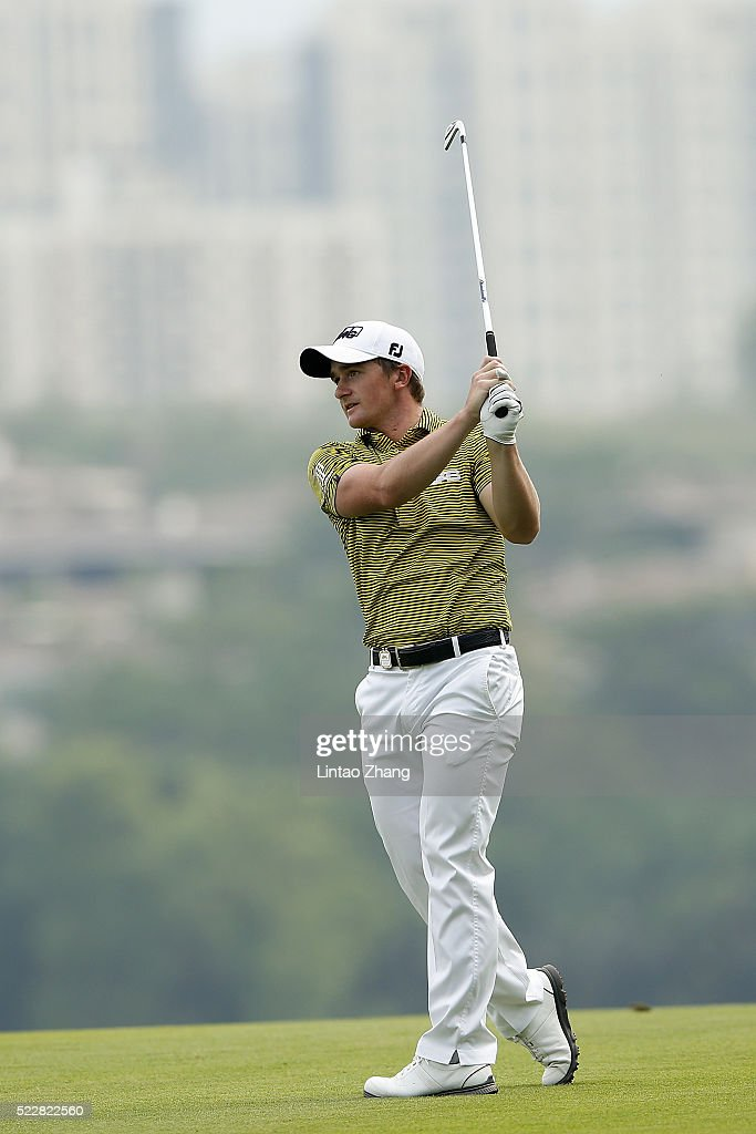 Paul Dunne of Ireland plays a shot during the first round of the Shenzhen International at Genzon Golf Club on April 21, 2016 in Shenzhen, China. Photo by Lintao Zhang/Getty Images)