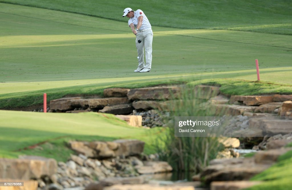Paul Dunne of Ireland plays his second shot on the 18th hole during the second round of the DP World Tour Championship on the Earth Course at Jumeirah Golf Estates on November 17, 2017 in Dubai, United Arab Emirates.