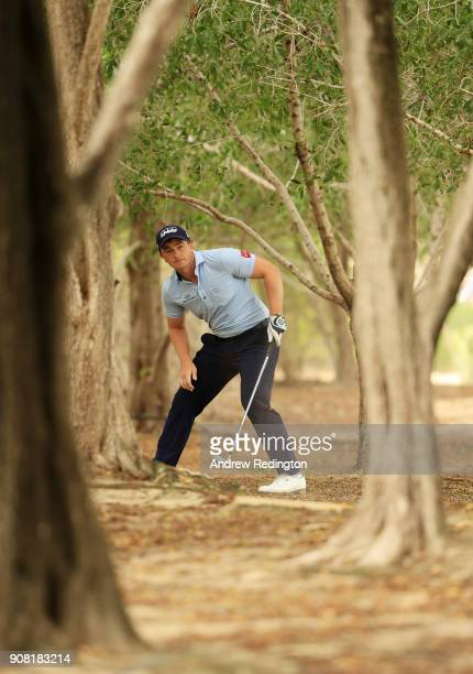 Paul Dunne of Ireland plays his second shot on the second hole during the final round of the Abu Dhabi HSBC Golf Championship at Abu Dhabi Golf Club...