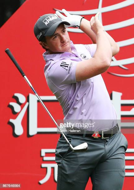 Paul Dunne of Ireland plays his shot from the third tee during the final round of the WGC HSBC Champions at Sheshan International Golf Club on...