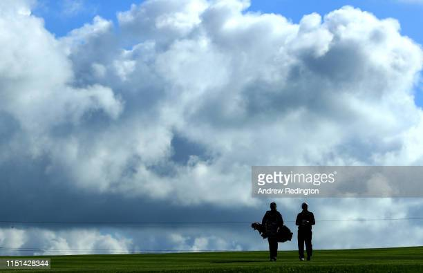 Paul Dunne of Ireland walks with caddie Darren Reynolds on the 17th hole during the second round of the Made in Denmark at Himmerland Golf Spa Resort...