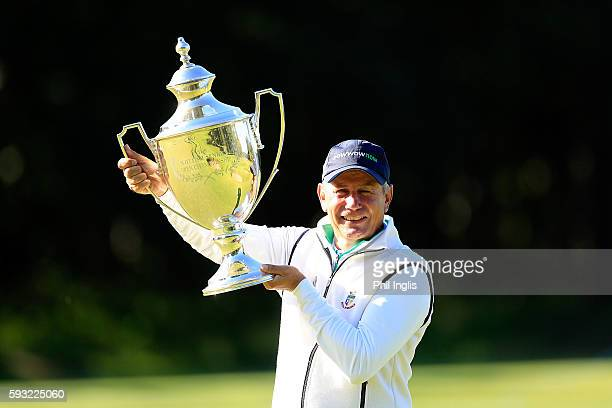 Paul Eales of England poses with the trophy after the final round of the Prostate Cancer UK Scottish Senior Open played over the Fidra Course...
