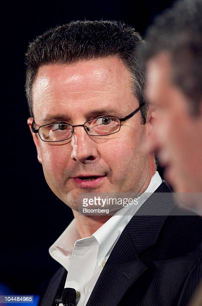 Paul Edwards, executive director of marketing strategy with General Motors Co., left, speaks with Darren Huston, corporate vice president of global...