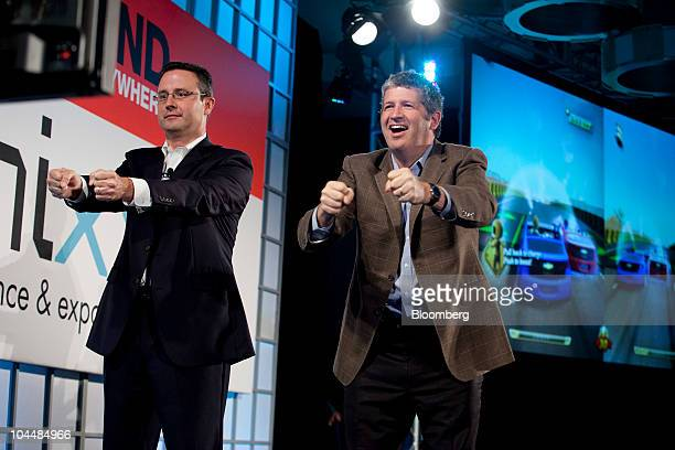 Paul Edwards executive director of marketing strategy with General Motors Co left and Darren Huston corporate vice president of global consumer and...
