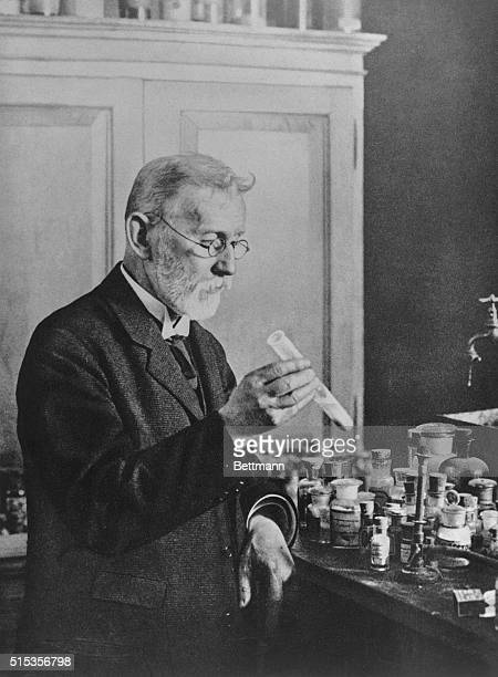 Paul Ehrlich holding a test tube. An undated photograph.
