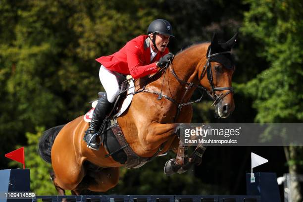 Paul Estermann of Switzerland riding Lord Pepsi competes during Day 3 of the Longines FEI Jumping European Championship speed competition against the...