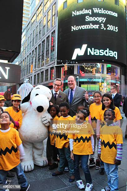 Paul Feig David Wicks and Snoopy from 'The Peanuts Movie' ring the NASDAQ closing bell at NASDAQ MarketSite on November 3 2015 in New York City