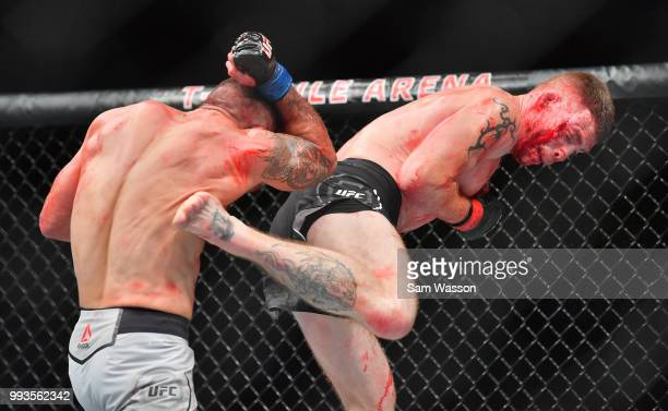 Paul Felder kicks Mike Perry during their welterweight fight at TMobile Arena on July 7 2018 in Las Vegas Nevada Perry won by split decision