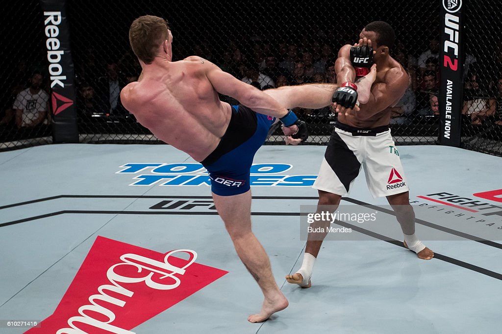 Paul Felder of the United States kicks Francisco Trinaldo of Brazil in their lightweigh UFC bout during tthe UFC Fight Night event at Nilson Nelson gymnasium on September 24, 2016 in Brasilia, Brazil.