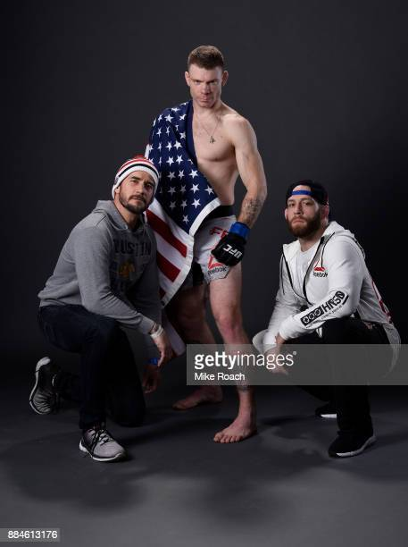 Paul Felder poses with teammate CM Punk for a post fight portrait backstage during the UFC 218 event inside Little Caesars Arena on December 02 2017...