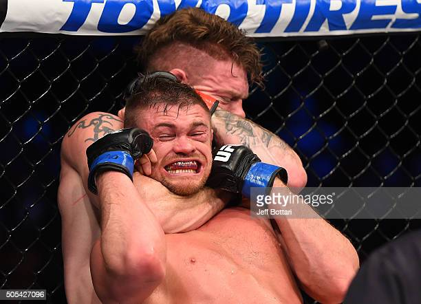 Paul Felder secures a rear choke submission against Daron Cruickshank in their lightweight bout during the UFC Fight Night event inside TD Garden on...