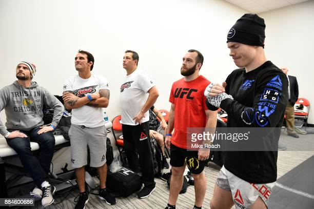 Paul Felder warms up with his coaches and CM Punk backstage during the UFC 218 event inside Little Caesars Arena on December 02 2017 in Detroit...
